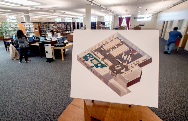 A rendering on display at the Washington District Library gives patrons an idea of what the new look and layout of the facility will be once renovations are complete. Besides a new design, the library will also get new carpet and a new paint scheme.