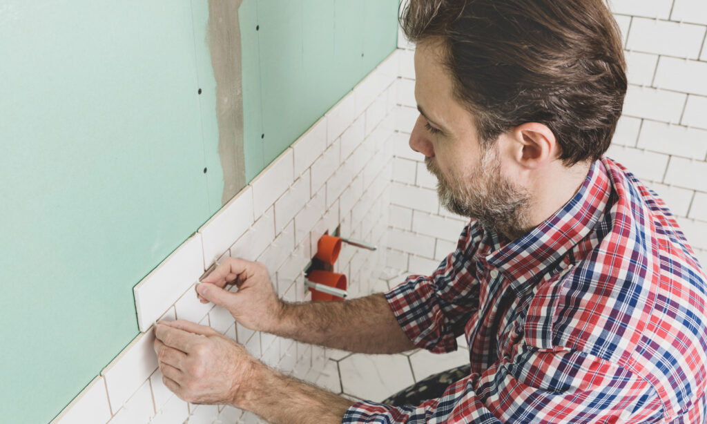 Stock image of a man tiling